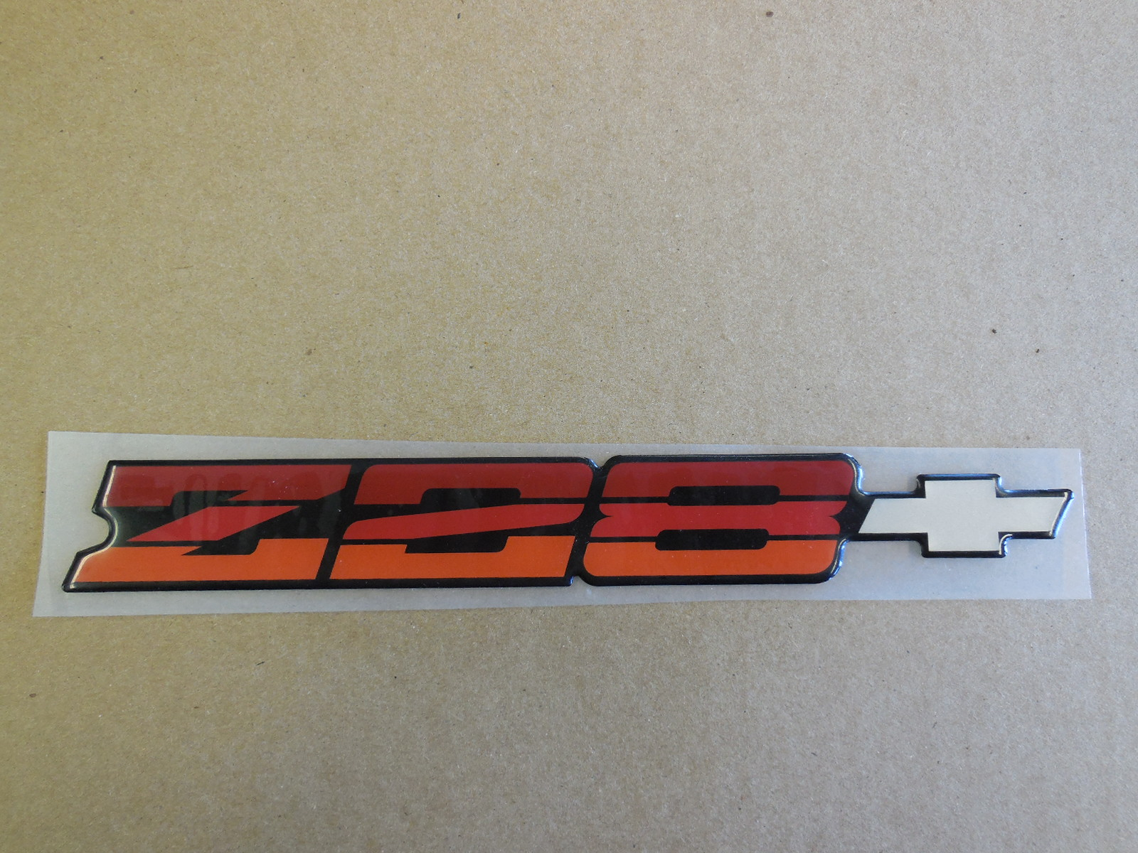 NOS GM 1985-1990 Camaro Z28 Rear Bumper Emblem | GM Sports
